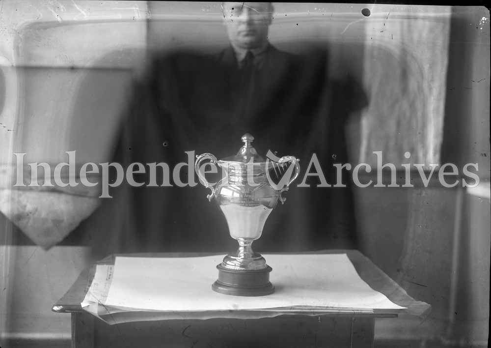 Transatlantic Fliers in Dublin. Picture of man and Trophy, name unknown, 1934.<br /> (Part of the Independent Newspapers Ireland/NLI Collection)
