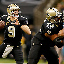 Dec 7, 2014; New Orleans, LA, USA; New Orleans Saints quarterback Drew Brees (9) against the Carolina Panthers during the first half of a game at the Mercedes-Benz Superdome. Mandatory Credit: Derick E. Hingle-USA TODAY Sports