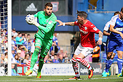 Ipswich goalkeeper Bartosz Bialkowski saves from Barnsley midfielder Adam Hammill during the EFL Sky Bet Championship match between Ipswich Town and Barnsley at Portman Road, Ipswich, England on 6 August 2016. Photo by Nigel Cole.