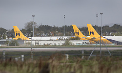 © Licensed to London News Pictures. 02/10/2017. Crawley, UK. Three Monarch Airlines aircraft are seen parked at Gatwick Airport after it was announced that the airline has ceased trading. The government has announced that it will start the country's biggest ever peacetime repatriation to fly about 110,000 stranded passengers home. Photo credit: Peter Macdiarmid/LNP