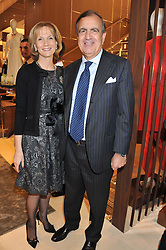 The Italian Ambassador to the UK ALAIN GIORGIO MARIA ECONOMIDES and CARRIE CUNNINGHAM at the Salvatore Ferragamo Old Bond Street Boutique Store Launch on 5th December 2012.