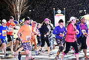 Runners make their way down Dominique Wilkins Lane at the start of the Publix Georgia Marathon & Half Marathon on Sunday, March 22, 2015, in Atlanta. David Tulis / AJC Special