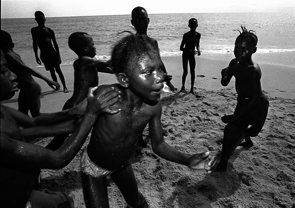 St. Michaels, Lakka, Sierra Leone. April 1999..Children play on the beautiful Lakka beach, once a holiday resort for upper class French tourists and now serving as a rehabilitation centre for boy soldiers of the civil war in Sierra Leone.