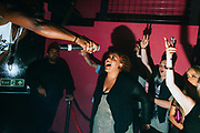 Queen Ebony passes the microphone to crowd during a performance of UK Grime. Brighton 2014