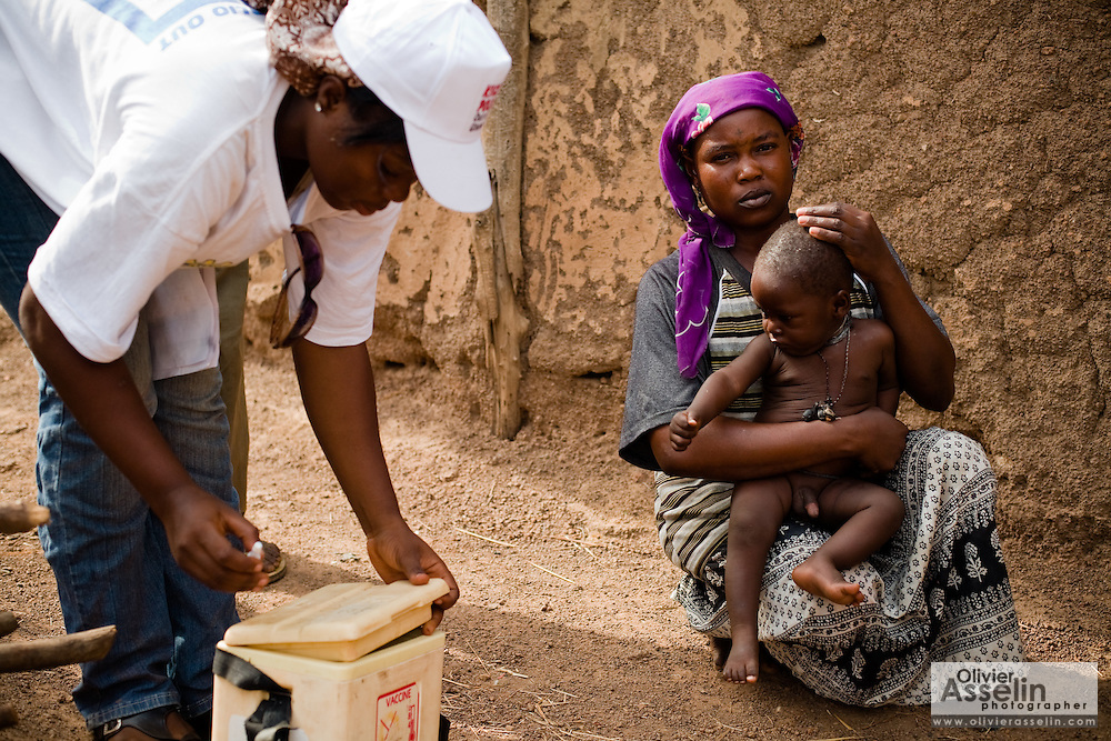 A health worker prepares to vaccinate a child during a national polio immunization exercise in the village of Gidan-Turu, northern Ghana on Thursday March 26, 2009.