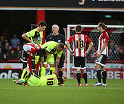 Brentford midfielder Toumani Diagouraga fouling Hudderfield Town striker Joe Lolley during the Sky Bet Championship match between Brentford and Huddersfield Town at Griffin Park, London, England on 19 December 2015. Photo by Matthew Redman.