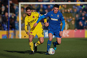 AFC Wimbledon midfielder Anthony Hartigan (8) battles for possession with Fleetwood Town attacker Ched Evans (9) during the EFL Sky Bet League 1 match between AFC Wimbledon and Fleetwood Town at the Cherry Red Records Stadium, Kingston, England on 8 February 2020.