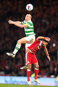 Celtic midfielder Scott Brown (#8) rises above Aberdeen forward Wes Burns (#8) to win a header during the Scottish Cup final match between Aberdeen and Celtic at Hampden Park, Glasgow, United Kingdom on 27 November 2016. Photo by Craig Doyle.
