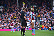 Aston Villa defender Jordan Amavi (23) shown yellow card by referee Mr Coote during the EFL Sky Bet Championship match between Fulham and Aston Villa at Craven Cottage, London, England on 17 April 2017. Photo by Jon Bromley.