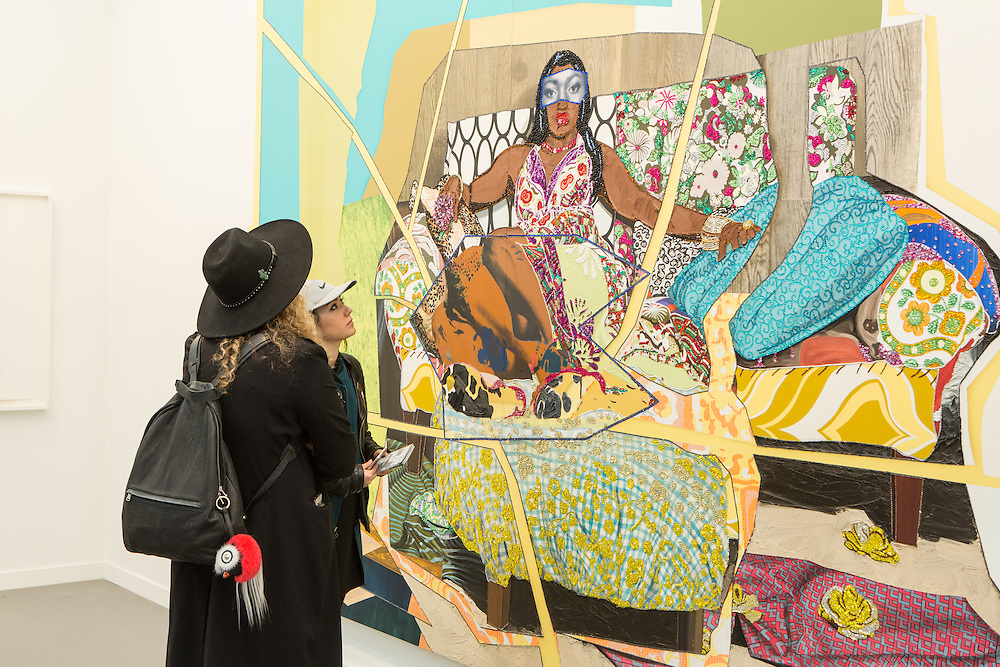 "New York, NY - 6 May 2016. Frieze New York art fair. Two women look at Mickalene Thomas's ""I'm Feelin Good"" [sic.] in the Lehman Maupin Gallery. The gallery has a pressence in New York and Hong Kong."