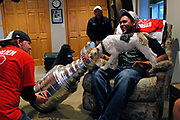 Former Chicago Blackhawks' Dustin Byfuglien laughs as his dog Walter drinks beer out of the Stanley Cup while he relaxes with his friends during down time during a busy day of Stanley Cup festivities in his home town of Roseau, Minnesota on Sunday, August 15, 2010.<br />  (Tribune Photo by Scott Strazzante)  B58644156Z.1<br /> ....OUTSIDE TRIBUNE CO.- NO MAGS,  NO SALES, NO INTERNET, NO TV, NEW YORK TIMES OUT, CHICAGO OUT, NO DIGITAL MANIPULATION...