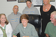Oxford High tennis player Will Huntington signs to play at Meridian Community College on Monday, April 26, 2010.