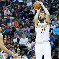 08 March 2016: Denver Nuggets center Joffrey Lauvergne (77) takes a jump shot next to Denver Nuggets guard Axel Toupane (6) during the Denver Nuggets 110-94 victory over the New York Knicks, at the Pepsi Center, Denver, Colorado, USA.