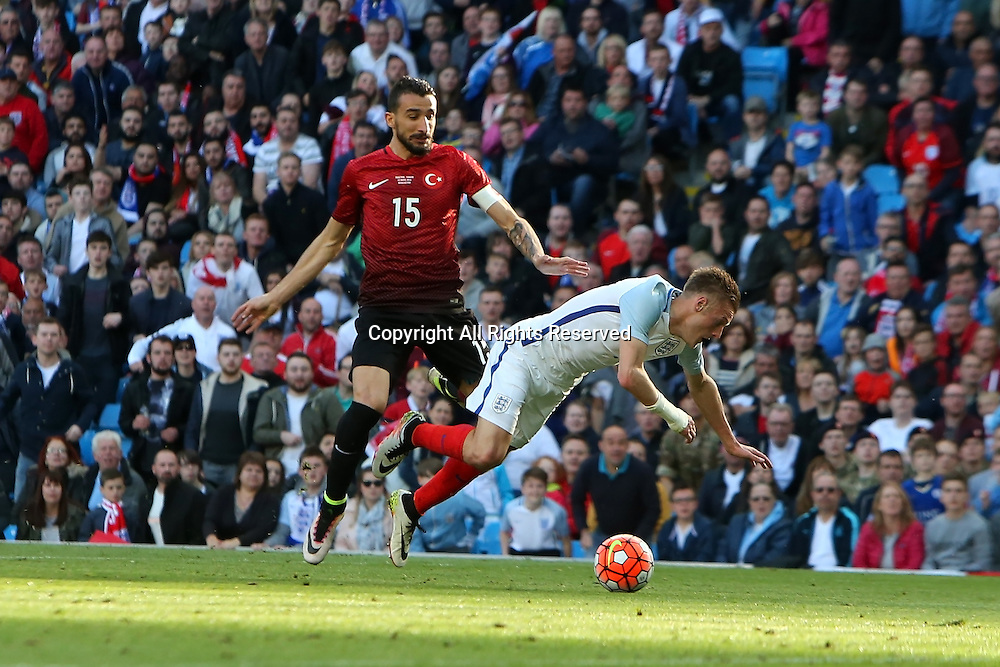 22.05.2016. Etihad Stadium, Manchester, England. International football friendly match, England versus Turkey. Jamie Vardy of England is brought down by Turkey captain Mehmet Topal for a penalty.