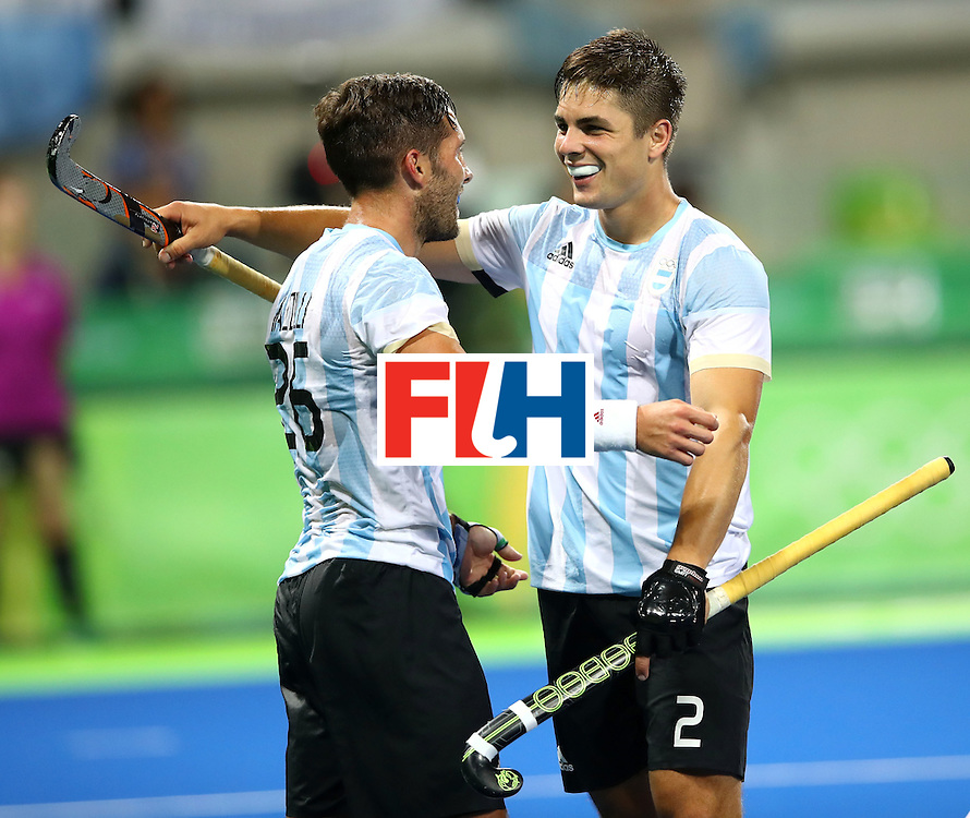 RIO DE JANEIRO, BRAZIL - AUGUST 18:  Agustin Mazzilli #26 of Argentina and Gonzalo Peillat #2 of Argentina celebrate winning in the Men's Hockey Gold Medal match between Belgium and Argentina on Day 13 of the Rio 2016 Olympic Games at Olympic Hockey Centre on August 18, 2016 in Rio de Janeiro, Brazil.  (Photo by Clive Brunskill/Getty Images)