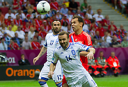 Dimitris Salpingidis  of Greece vs Sergei Ignashevich of Russia during the UEFA EURO 2012 group A match between  Greece and Russia at The National Stadium on June 16, 2012 in Warsaw, Poland.  (Photo by Vid Ponikvar / Sportida.com)