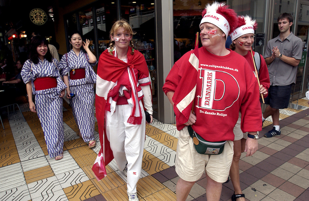 Denmark soccer supporters and Kimono wearing Japanese girls share a walk through Niigata's streets during the World Cup Japan 2002.©David Dare Parker Rapho/Network