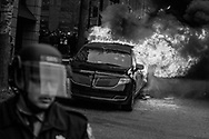 A parked limousine burns during a demonstration after the inauguration of President Donald Trump, Friday, Jan. 20, 2017, in Washington. Protesters registered their rage against the new president Friday in a chaotic confrontation with police who used pepper spray and stun grenades in a melee just blocks from Donald Trump's inaugural parade route. Scores were arrested for trashing property and attacking officers.