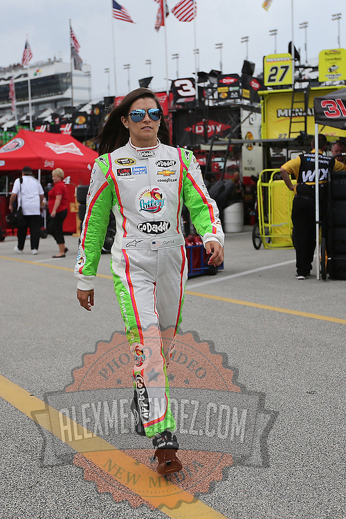 Driver Danica Patrick walks to her garage area during the first practice session of the 56th Annual NASCAR Coke Zero400 race at Daytona International Speedway on Thursday, July 3, 2014 in Daytona Beach, Florida.  (AP Photo/Alex Menendez)