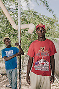 Sanu Bresil, 23, from Cabral, Dominican Republic photographed at the Fond Bayord School in Malpasse, Haiti where he staying along with other Haitians deported from Dominican Republic. <br /> <br /> At left is Sunel Jean Joseph, 15, who was deported with his father. Both young men are effectively stateless. They both were born in Dominican Republic to parents also born there but now live in Haiti, where they don't have citizenship or family.