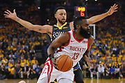 April 30, 2019; Oakland, CA, USA; Houston Rockets guard James Harden (13) dribbles the basketball against Golden State Warriors guard Stephen Curry (30) during the first quarter in game two of the second round of the 2019 NBA Playoffs at Oracle Arena.