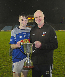 Claremorris&rsquo;s Padraig Cummins celebrating the Mayo U21 victory with team selector and  Dad Johnny.<br />Pic Conor McKeown