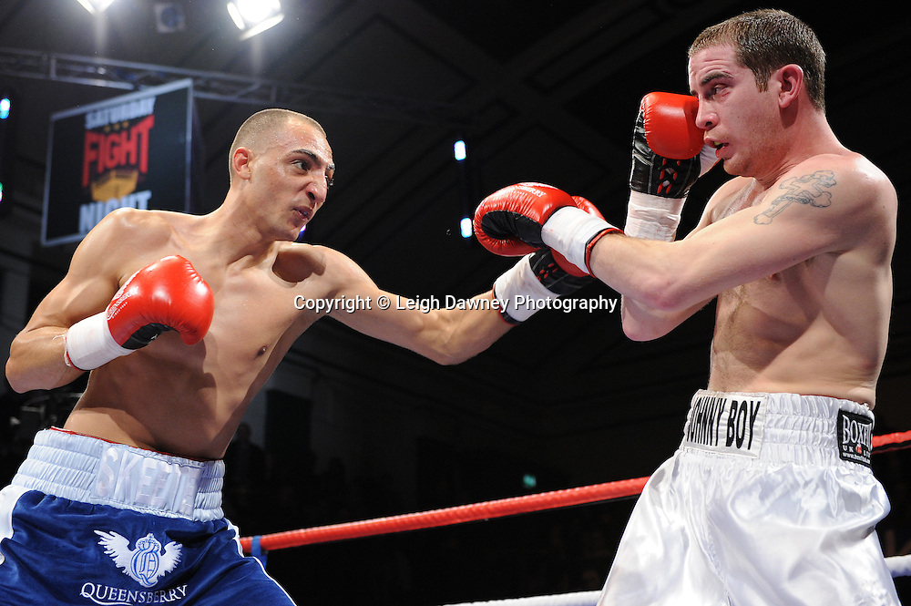 Welterweight Bradley Skeete (white/blue shorts) defeats Johnny Greaves at York Hall, Bethnal Green, London on the 19th February 2011. Frank Warren Promotions. Photo credit © Leigh Dawney.