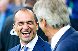 Everton Manager, Roberto Martinez shares a joke with Manchester City Manager, Manuel Pellegrini   - Mandatory byline: Matt McNulty/JMP - 07966386802 - 23/08/2015 - FOOTBALL - Goodison Park -Everton,England - Everton v Manchester City - Barclays Premier League