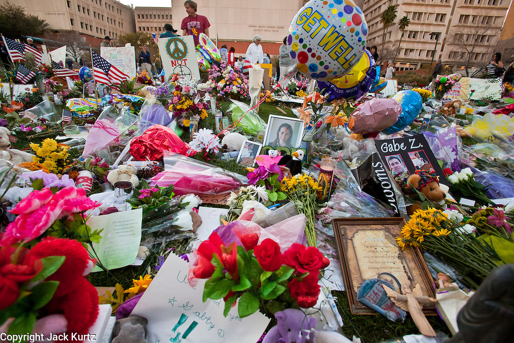 "15 JANUARY 2011 - TUCSON, AZ: The memorial on the lawn in front of the University Medical Center in Tucson, AZ, Saturday, January 15. The memorial has been growing since the mass shooting last week. Six people were killed and 14 injured in the shooting spree at a ""Congress on Your Corner"" event hosted by Congresswoman Gabrielle Giffords at a Safeway grocery store in north Tucson on January 8. Congresswoman Giffords, the intended target of the attack, was shot in the head and seriously injured in the attack. She is hospitalized at UMC. The alleged gunman, Jared Lee Loughner, was wrestled to the ground by bystanders when he stopped shooting to reload the Glock 19 semi-automatic pistol. Loughner is currently in federal custody at a medium security prison near Phoenix.  Photo by Jack Kurtz / ZUMA Press"