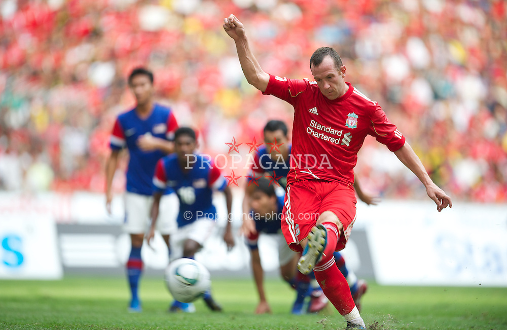 KUALA LUMPUR, MALAYSIA - Saturday, July 16, 2011: Liverpool's new signing Charlie Adam scores the first goal from the penalty spot against a Malaysia XI at the National Stadium Bukit Jalil in Kuala Lumpur on day six of the club's Asia Tour. (Photo by David Rawcliffe/Propaganda)