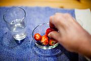 A pensioneer eating strawberries.