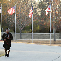 Adam Robison | BUY AT PHOTOS.DJOURNAL.COM<br /> Torren Carruthers, of Tupelo, runs through Veterans Park in Tupelo as the trains for the United States Air Force. Carruthers runs 6 miles a day and Veterans Park marks the 2 mile point in his run.