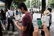 People plays pokemon go in the street of Tokyo. The Japanese version of the game app Pokemon Go was released on July 22, 2016. Japan McDonalds' 3,000 restaurants in Japan will be turned into Pokemon gyms in collaboration with the fast-food chain. 22/07/2016-Tokyo, JAPAN