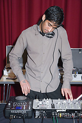 DJ using mixing desk to make music,