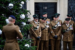 © Licensed to London News Pictures. 14/12/2016. London, UK. Members of The Rifles regiment within the British Army pose for a photograph outside 10 Downing Street in London after meeting with British prime minister Theresa May at a reception for a Military awards. Photo credit: Ben Cawthra/LNP