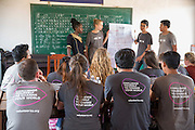 ICS volunteer attend their Active citizen day to learn about deforestation both locally and internationally presented by Keira Thompson, Tania Tuzizila, Vannak Uch, & Luna Boran. The session takes place in the library of the local school in Banteay Char, near Battambang, Cambodia.