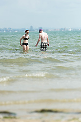 © Licensed to London News Pictures. 14/06/2014. Ryde, Isle of Wight, UK. People venture into the sea on a hot sunny morning.  The UK is experiencing a period of hot sunny weather with temperatures over the weekend expected to reach 74 F (23 C).  Photo credit : Richard Isaac/LNP