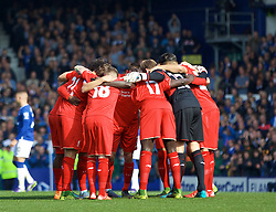 LIVERPOOL, ENGLAND - Sunday, October 4, 2015: Liverpool players form a pre-match huddle before the Premier League match against Everton at Goodison Park, the 225th Merseyside Derby. (Pic by Lexie Lin/Propaganda)