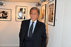 Designer VALENTINO GARAVANI at a private view of photographs by Anthony Souza held at The Little Black Gallery, 13A Park Walk, London SW10 on 13th December 2011.