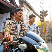 Jan 16, 2013 - The youth of India are feeling a new found wealth in a burgeoning economy where hip young friends cruise the streets of Kolkata, India, in the evening. <br /> <br /> Story Summary: It is said that the battle over global warming is to be won or lost in Asia. With growing populations and new economic boom in the global markets across Asia countries like India, Nepal and Cambodia have to grapple with the success and the environmental disaster that comes with ramped up production in unchecked or unregulated industries to compete in todays marketplace. The catastrophic air pollution makes for new problems to be dealt with such as a future health crisis, quality of life issues and the tarnished image of reduced visibility to world heritage sites for tourism.
