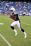 SAN DIEGO, CA - AUGUST 30:  The Chargers first round pick in the 2007 NFL Draft, rookie wide receiver Craig Davis #84 of the San Diego Chargers runs with a ball during pregame warmups at the NFL preseason game with the San Francisco 49ers at Qualcomm Stadium on August 30, 2007 in San Diego, California. The Chargers defeated the 49ers 16-13. ©Paul Anthony Spinelli *** Local Caption *** Craig Davis