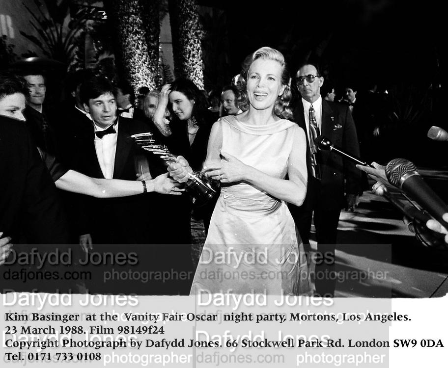 Kim Basinger  at the  Vanity Fair Oscar  night party, Mortons, Los Angeles. 23 March 1988. Film 98149f24<br />Copyright Photograph by Dafydd Jones<br />66 Stockwell Park Rd. London SW9 0DA<br />Tel. 0171 733 0108