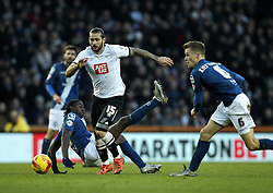 Bradley Johnson of Derby County gets past a falling Clayton Donaldson of Birmingham City - Mandatory byline: Robbie Stephenson/JMP - 16/01/2016 - FOOTBALL - iPro Stadium - Derby, England - Derby County v Birmingham City - Sky Bet Championship