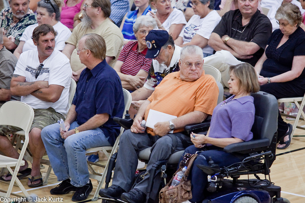 """Aug 10, 2009 -- CHANDLER, AZ: People in Chandler, AZ, wait for a town hall meeting on health care reform to start in Chandler, AZ. Rep. Jeff Flake, (R-AZ) hosted a """"town hall"""" style meeting on health care reform at Basha High School in Chandler Monday. Flake, a conservative Republican, has opposed President Obama on many issues, like the stimulus and health care reform. Protestors who have shut down similar meetings hosted by Democrats, gave Flake a warm welome. About 1,600 people attended the meeting.   Photo by Jack Kurtz"""