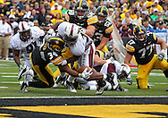September 24, 2011: Iowa Hawkeyes running back Marcus Coker (34) reaches across the goal line for a touchdown as he is hit by Louisiana Monroe Warhawks safety Darius Prelow (37) on a 2 yard run during the third quarter of the game between the Iowa Hawkeyes and the Louisiana Monroe Warhawks at Kinnick Stadium in Iowa City, Iowa on Saturday, September 24, 2011. Iowa defeated Louisiana Monroe 45-17.