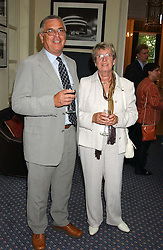 BRIAN & PAT MOSS at a party to celebrate the publication of 'An Act of Peace' by Ann Widdecombe at 11 Carlton House Terrace, London on 19th July 2005.<br />