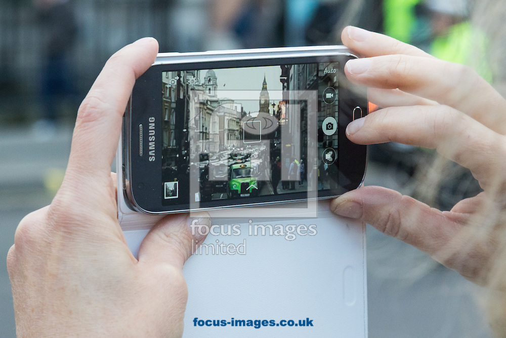 A member of the public snaps a picture of Whitehall, clogged with taxis as an estimated 8,000 cabbies protest against &quot;unfair competition&quot; from Uber mini cabs<br /> Picture by Paul Davey/Focus Images Ltd +447966 016296<br /> 10/02/2016