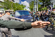 23 MAY 2014 - BANGKOK, THAILAND: Thai police try to clear the way fro a van thought to be carrying former Thai Prime Minister Yingluck Shinawatra into a military compound in Bangkok. Yingluck was ordered to turn herself by the Thai army General Prayuth Ocha-chan. She is thought to be in military custody. The Thai military seized power in a coup Thursday evening. They suspended the constitution and ended civilian rule. This is the 2nd coup in Thailand since 2006 and at least the 12th since 1932.    PHOTO BY JACK KURTZ