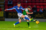 Michael O'Halloran (#17) of St Johnstone FC tackles Lewis Stevenson (#16) of Hibernian FC during the Ladbrokes Scottish Premiership match between St Johnstone FC and Hibernian FC at McDiarmid Park, Perth, Scotland on 9 November 2019.