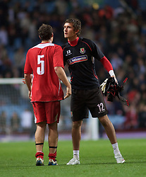 BIRMINGHAM, ENGLAND - Monday, October 13, 2008: Wales' Darcy Blake and goalkeeper Rhys Taylor look dejected after losing to England during the UEFA European Under-21 Championship Play-Off 2nd Leg match at Villa Park. (Photo by Gareth Davies/Propaganda)